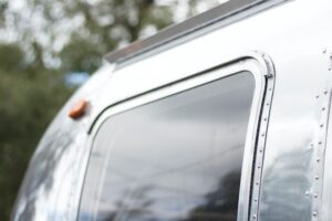 A Close-Up of the Almost Reflective Surface of an Airstream Trailer