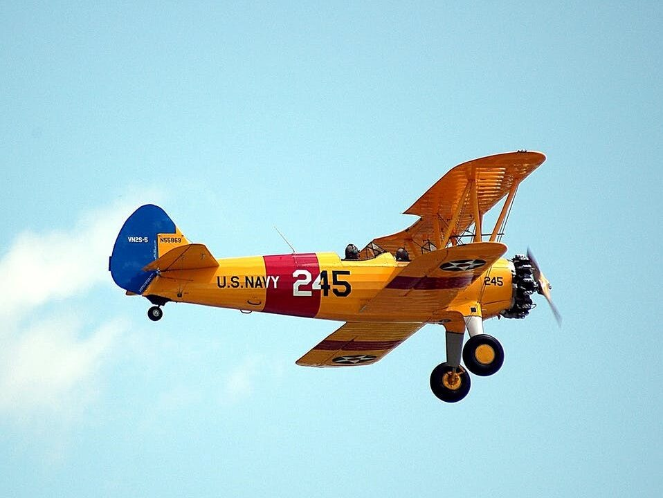 A Flying Aircraft with a Yellow and Red Frame and Blue Tip